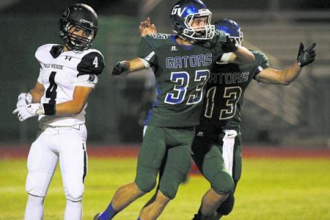 Green Valley kicker Conor Perkins (33) celebrates with  holder Kyler Chavez (13) after ...