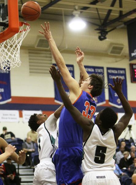 Gorman's Stephen Zimmerman tries for a basket while being double-teamed by Sheldon&#82 ...
