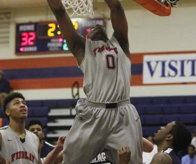 Findlay Prep's Horace Spencer (0) grabs a rebound on Saturday against Impact Academy. ...