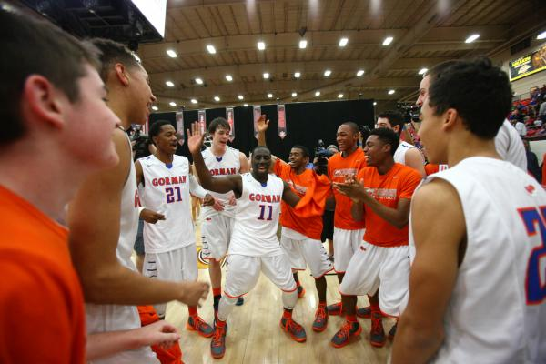 Bishop Gorman players, led by Obim Okeke (11) celebrate their 76-72 overtime win over Findla ...