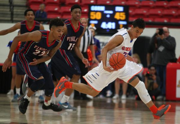 Bishop Gorman's Richie Thornton, right, tries to elude Findlay Prep's Justin Jac ...