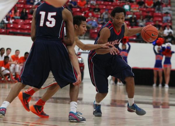 Findlay Prep's Rashad Vaughn (1) gets a pick from teammate Justin Jackson (15) and dri ...