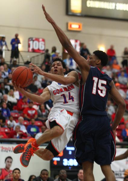 Bishop Gorman's Noah Robotham (14) goes for a layup against Findlay Prep's Justi ...