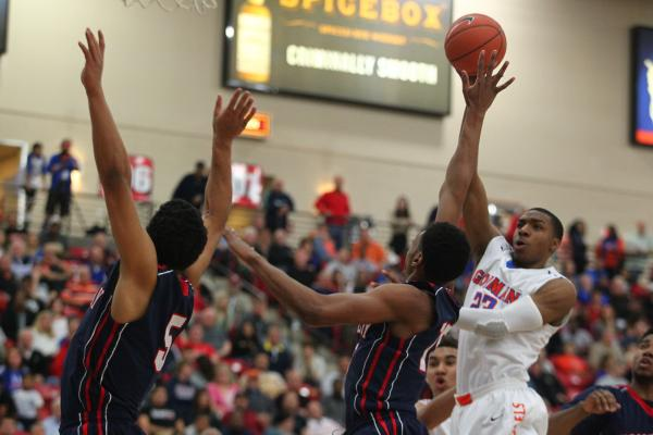 Chaparral's Tyree McNeal (35), center, takes a shot over Virgin Valley's defende ...