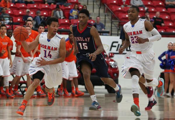 Bishop Gorman's Noah Robotham (14) looks for help from teammate Nick Blair (23) as Fin ...