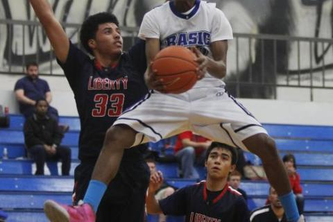 Basic's Robert Sutton drives against Liberty's Ed O'Bannon (33) during Thu ...