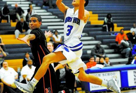 Sierra Vista's Mikko Balmes (3) drives past Mojave's Darryl Adams on Monday nigh ...