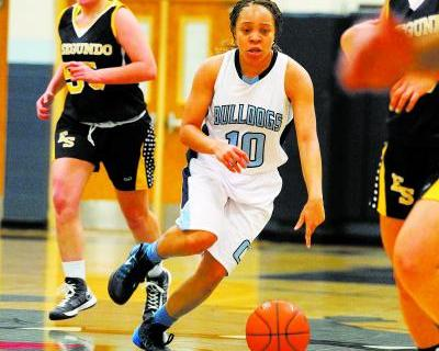 Centennial guard Tramina Jordan weaves between El Segundo (Calif.) defenders on Friday. Jord ...
