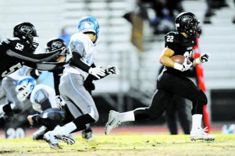 Palo Verde's Calvin Beaulieu (22) runs away from the Centennial defense.