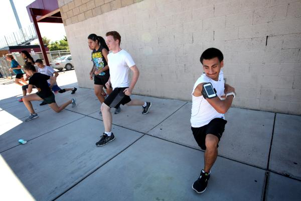 Eldorado cross country runner Eddie Esquivel, right, warms up before a recent practice.