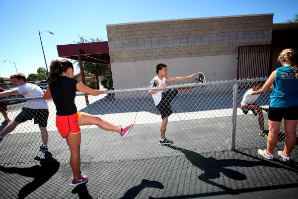 Eldorado cross country runner Eddie Esquivel, center, warms up before a recent practice.