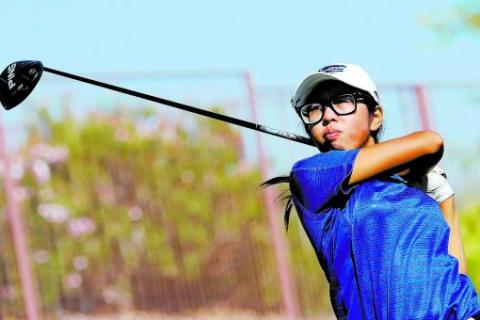 Green Valley junior Mercedes Khumnark watches her tee shot on the 10th hole during the final ...