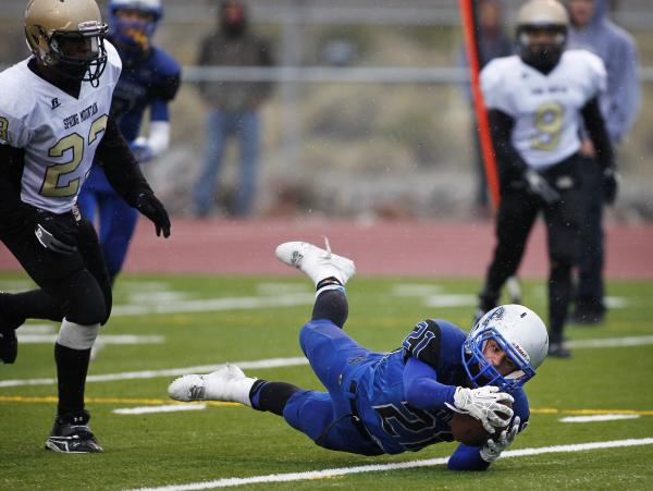 Pahranagat Valley's Jordan Cryts dives with the ball as Spring Mountain's Arias ...