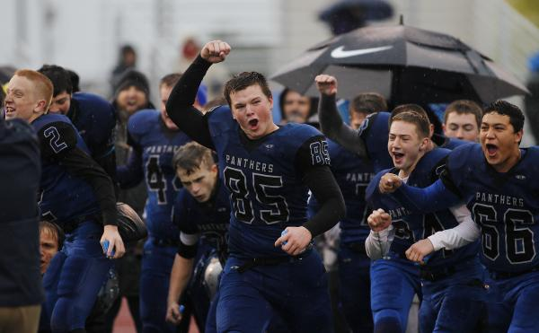 Pahranagat Valley's Jake Carter (85) leads his team in celebration as the Panthers win ...
