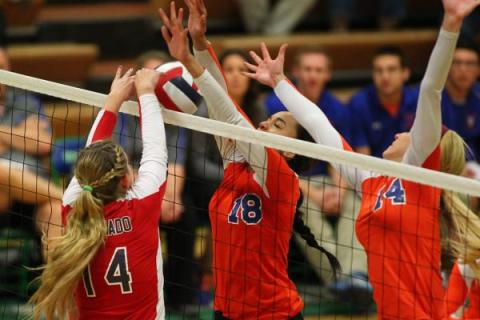 Coronado's Cali Thompson (14) tips the ball over the net against Bishop Gorman during ...