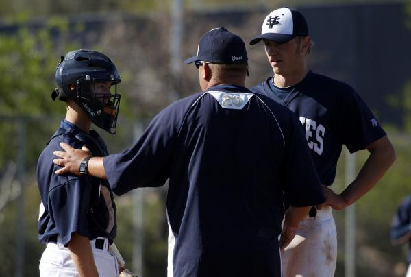 Spring Valley brothers Zane, left, and Dylan Drachler talk with coach Paul Bassett during a ...