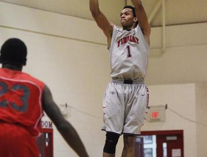 Findlay Prep's Rashad Vaughn (1) shoots a 3-point shot in front of Planet Athlete&#821 ...