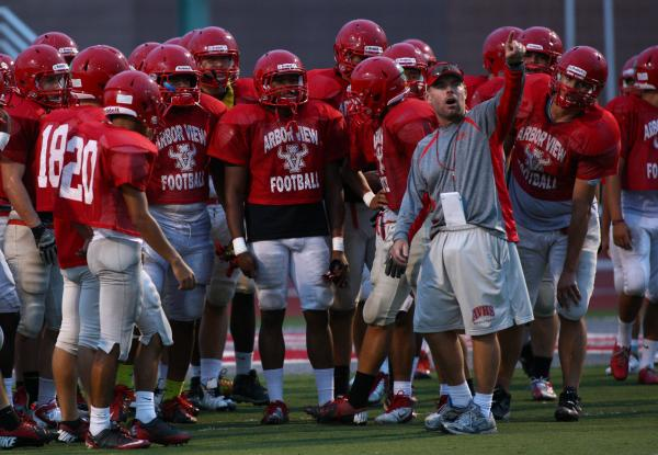 Arbor View football coach Dan Barnson talks to his team during Tuesday's practice. The ...