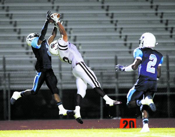 Canyon Springs' A.J. Cooper (3) breaks up a pass intended for Desert Oasis' Gary ...