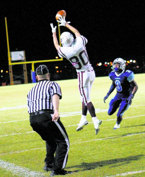 Desert Oasis' Shawn Sanchez (80) attempts to catch a pass in front of Canyon Springs&# ...