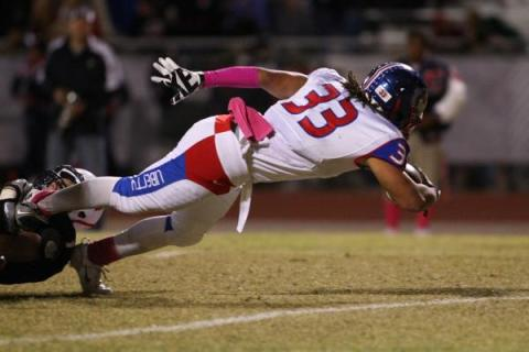 Liberty's Brenan Adams (33) leans across the goal line to score in a 45-27 win over Co ...
