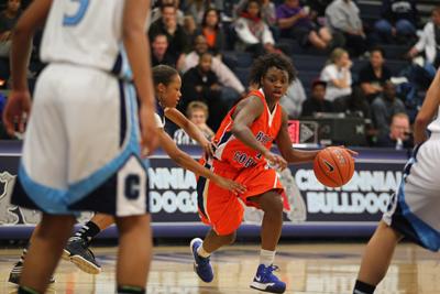 Bishop Gorman's Tonishia Childress drives through Centennial defense during a game at ...