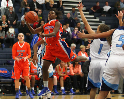 Bishop Gorman's Tonishia Childress attempts a shot against Centennial during a game at ...