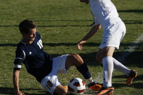 Legacy midfielder Luka Skrinjaric, left, goes for a slide tackle agains Palo Verde's & ...