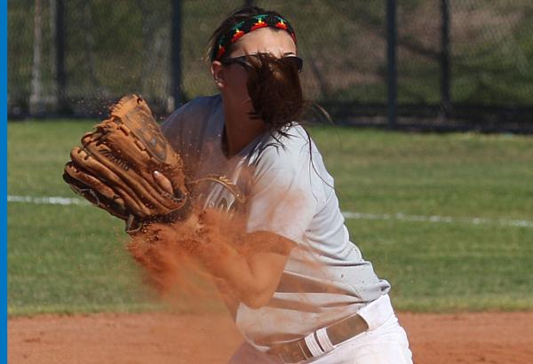 Green Valley softball player Cori Sutton is blinded by her ponytail on a throw to home in a ...