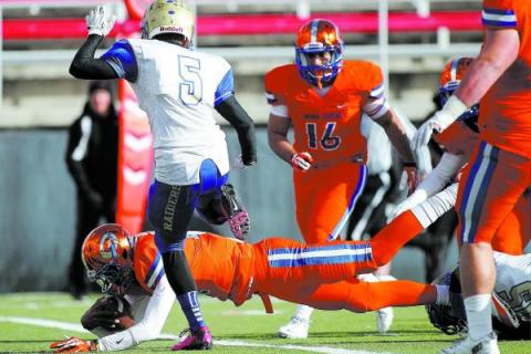 Bishop Gorman quarterback Randall Cunningham (12) dives into the end zone for a touchdown on ...
