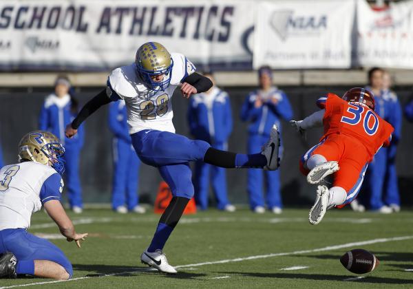 Bishop Gorman's Dylan Weldon (30) blocks a field goal attempt by Reed's Jesse Br ...