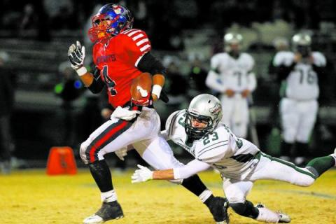 Liberty's Ethan Tuilagi (4) tries to run past Green Valley's Albert Lake. Tuilag ...