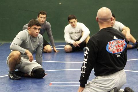 Green Valley wrestler Donovan Peek, left, listens to instructions from coach Jon Ferry durin ...