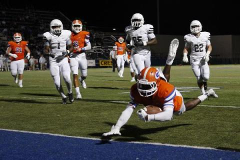 Bishop Gorman's Daniel Stewart dives into the end zone to score against Crespi (Calif. ...