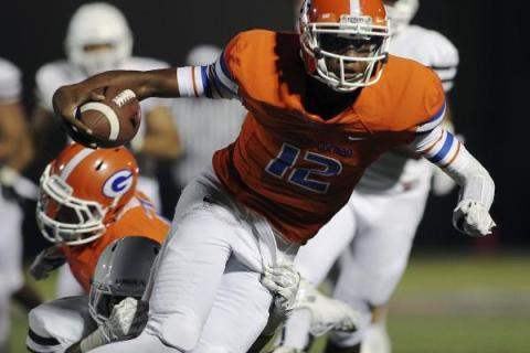 Bishop Gorman quarterback Randall Cunningham, seen carrying the ball against Crespi (Calif.) ...