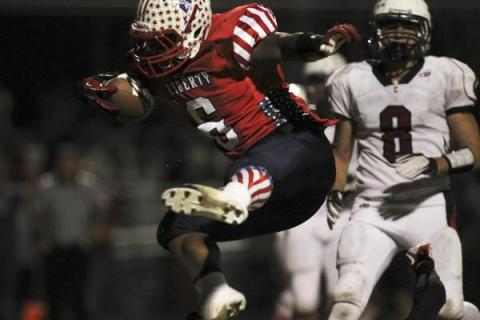 Liberty's Niko Kapeli, seen scoring a touchdown against Coronado, is one of eight play ...