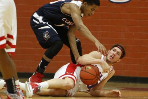Valley's Spencer Mathis, on ground, and Coronado's Eddie Austin battle for the b ...