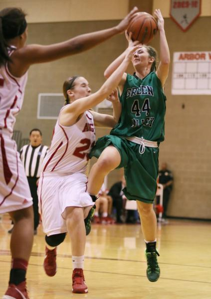 Green Valley freshman Brooke Haney (44) is fouled by Arbor View sophomore Katrina Nordstrom ...
