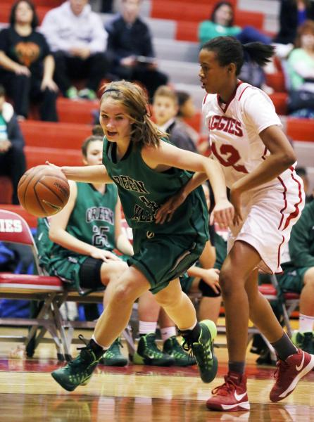 Green Valley freshman Brooke Haney, left, drives the ball past Arbor View junior Ariona Gill ...