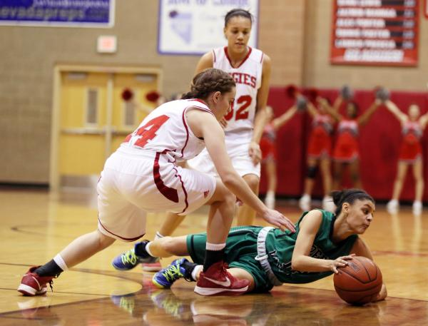 Arbor View senior Dani Chaney, left, and Green Valley senior Alexxus Johnson go after a loos ...