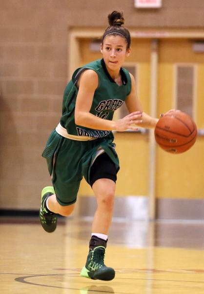 Green Valley senior Maggie Manwarren pushes the ball down the floor on Monday night.