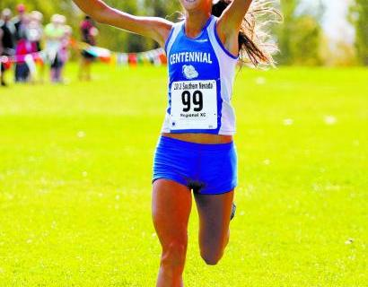 Centennial senior Sydney Badger crosses the finish line Saturday to win the Division I Sunse ...