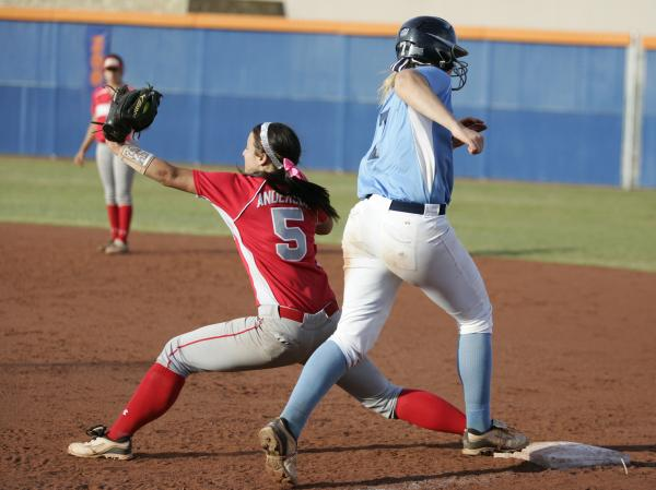 Arbor View's Kellie Anderson, left, stretches to take a throw and force out Taylor Hun ...