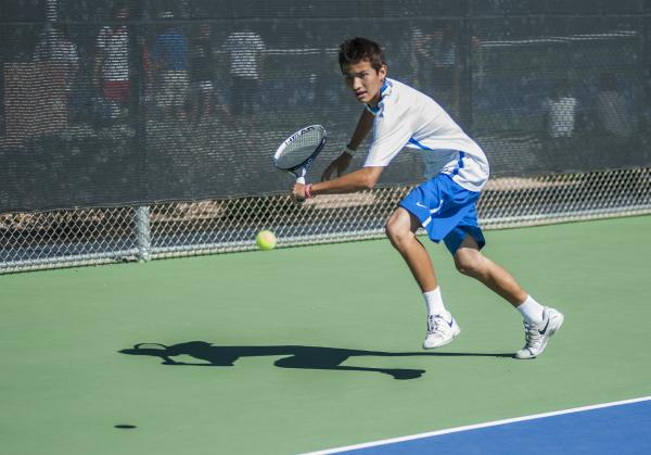Bishop Gorman's Dylan Levitt, reaches for a backhand in the boys singles final.