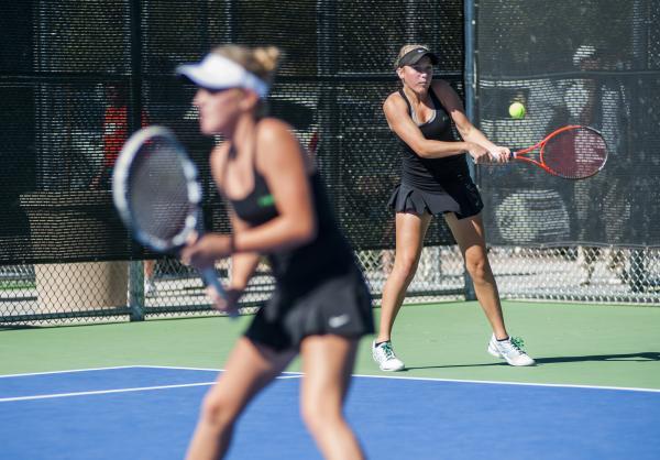 Palo Verde's Chloe Henderson, right, hits a backhand as Sophie Henderson waits near th ...