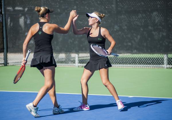 Palo Verde's Chloe Henderson, left, and Sophie Henderson celebrate in the girls double ...