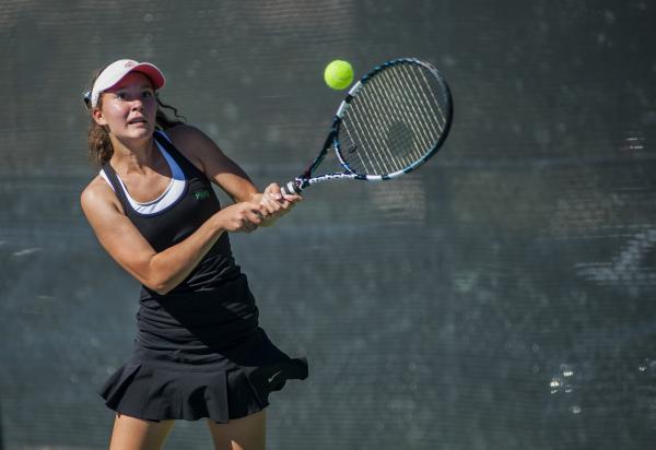 Palo Verde's Annie Walker hits a return in the girls singles title match.