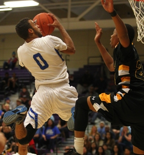 Desert Pines' Julian Jacobs shoots against Clark during the Division I-A Southern Regi ...