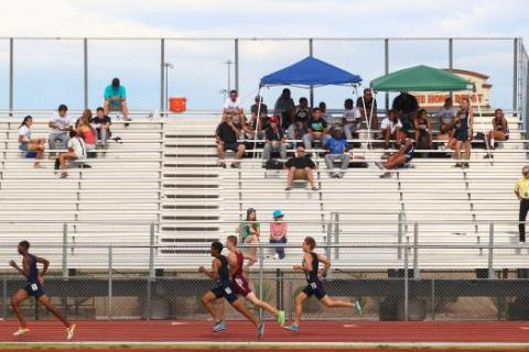 Centennial junior Tiana Bonds clears a hurdle on her way to victory in the 100-meter hurdles ...