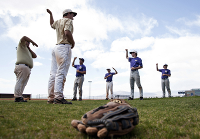 Members of the Sunrise Mountain High School varsity baseball team stretches before the start ...